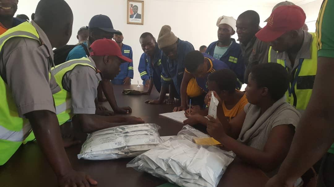 Distributing HIV self-test kits at work
